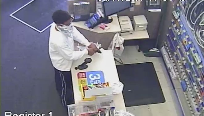 Surveillance footage shows a man who attempted to rob clerks at gunpoint at a Walgreens store in Avondale.