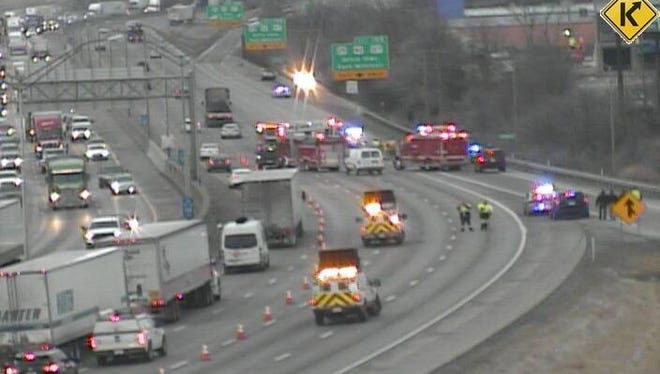Lanes are closed on SB I-71/75 near Kyles Lane after a person standing outside a vehicle was struck Friday morning.