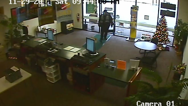 Still image from surveillance video that police say shows the Humboldt man who robbed the Check Into Cash store.