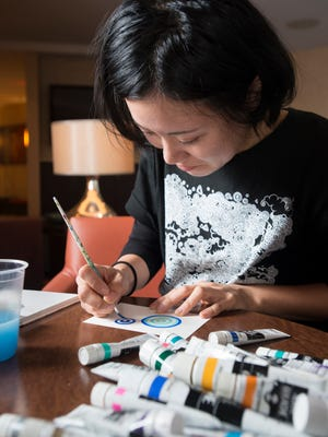 Artist Yume Matsuo, of Wakayama, Japan, creates a piece of art in Pensacola on Monday, October 30, 2017. Matsuo is this year's International Artist for the Great Gulfcoast Arts Festival, which will be Friday through Sunday in Seville Square.