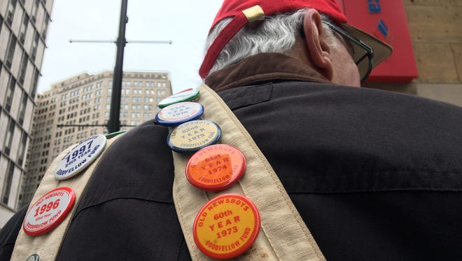 Barry Grant, 72, wears a Goodfellows newspaper bag with buttons dating back to 1972, the first year he started selling the papers for donations to help children. Grant sold them Nov. 28, 2016 outside the Guardian Building at Griswold and Congress.