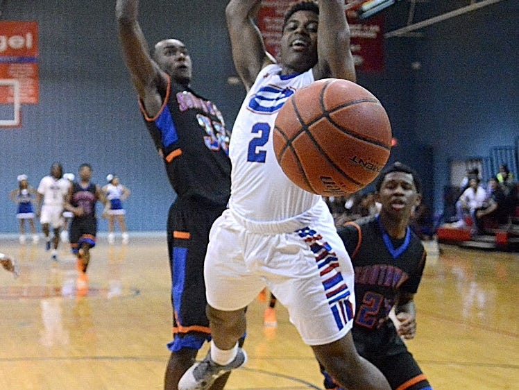 Evangel's Izavier West loses the ball in front of the Southwood defense on Friday night.