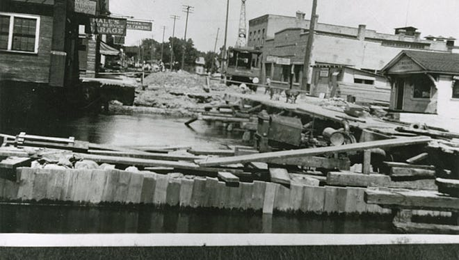 This northeast facing photograph shows bridge construction on North Commercial Street in Neenah, in 1926.