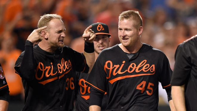 Baltimore Orioles' Mark Trumbo (45) celebrates after with Caleb Joseph (36) after Trumbo won a baseball game with a walkoff home run during the 12th inning of a baseball game against the Arizona Diamondbacks, Friday, Sept. 23, 2016, in Baltimore.