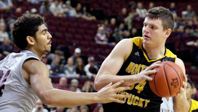 Northern Kentucky forward Drew McDonald (34) looks to pass around Texas A&M center Tyler Davis (34) during the second half of an NCAA college basketball game Tuesday, Dec. 19, 2017, in College Station, Texas. (AP Photo/Michael Wyke)