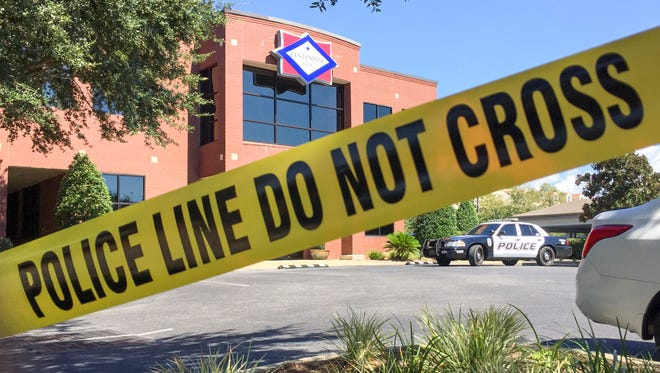 Police tape surrounds the Centennial Bank at 2200 Airport Blvd that was robbed on Tuesday, October 4, 2016.