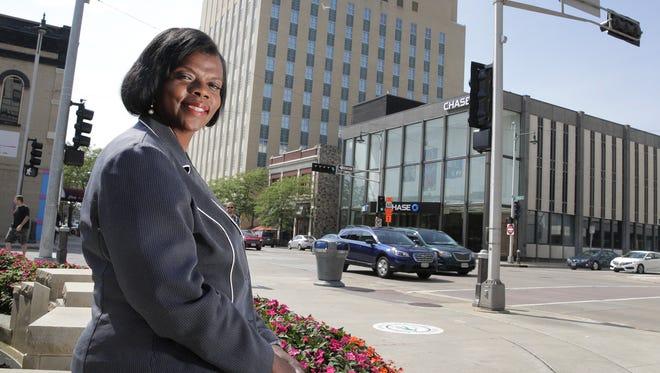 Karen Nelson, Appleton's new diversity coordinator, sits for a portrait in Houdini Plaza.