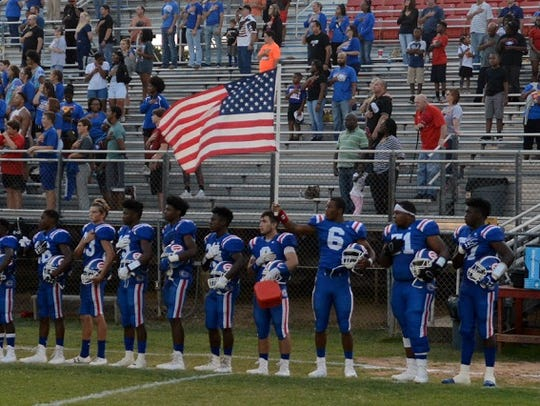 The Evangel football team shows its patriotism prior