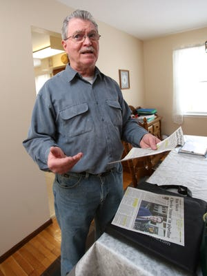 John Forkin in his Stony Point home Feb. 19, 2015. The Journal News articles is holding report that New York State property tax rebate checks were being sent out last fall, but he still hasn't received his.