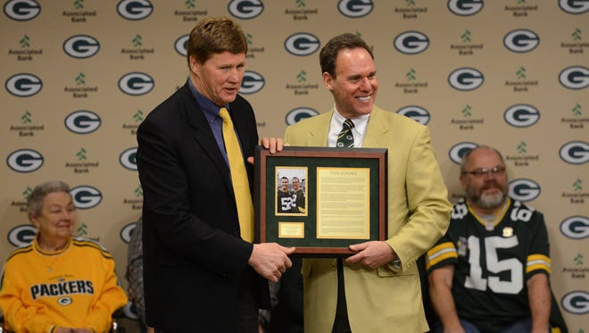 Green Bay Packers president and CEO Mark Murphy presents Steve Shumer, Gillette, NJ as the 17th member of the Green Bay Packers Fan Hall of Fame,