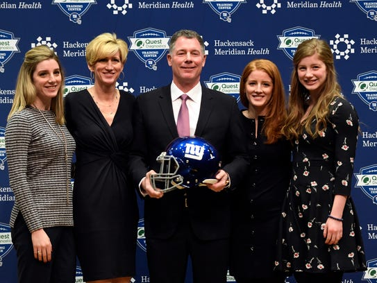 New Giants head coach Pat Shurmur poses with (left