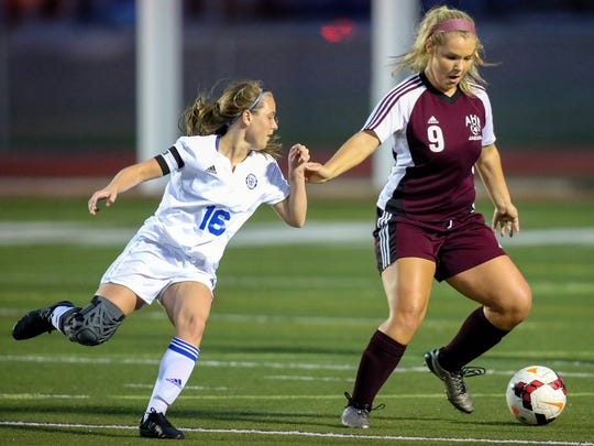Charter's Shannon McNulty (left) and Appoquinimink's Hannah Broomall work in the first half of a DIAA state tournament opening round game at Caravel Academy.