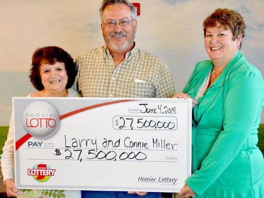 Connie and Larry Miller of Noblesville and Hoosier Lottery Executive Director Sarah Taylor at Hoosier Lottery headquarters today.