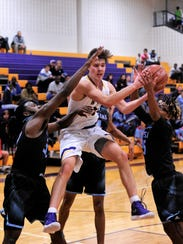 Wylie's Dylan Isenhower pulls down a rebound between