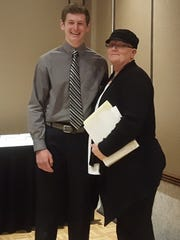 Optimist oratorical contest winner Ryan Begley stands with Diane Simon, chairwoman of the oratorical contest at the district level.