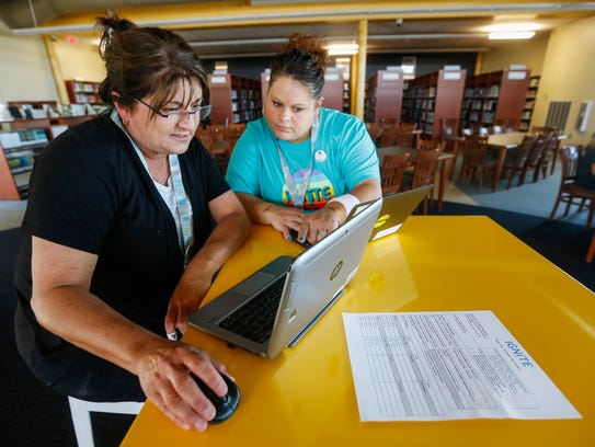 Janice Nance, left, and Nicki Dickson go over the modules