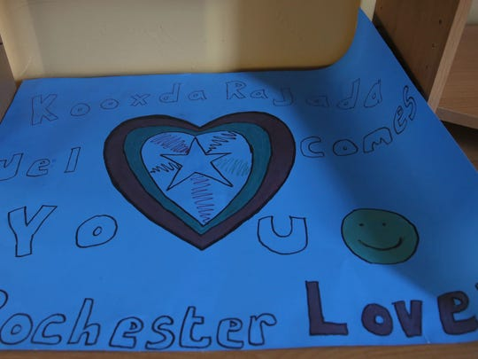 Upon arriving in Rochester, other refugees welcomed Aden and her family with this sign.