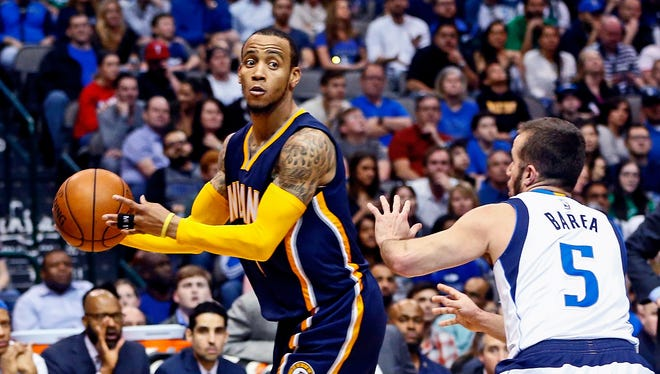 Indiana Pacers guard Monta Ellis (11) looks to pass as Dallas Mavericks guard J.J. Barea (5) defends during the second half at American Airlines Center.