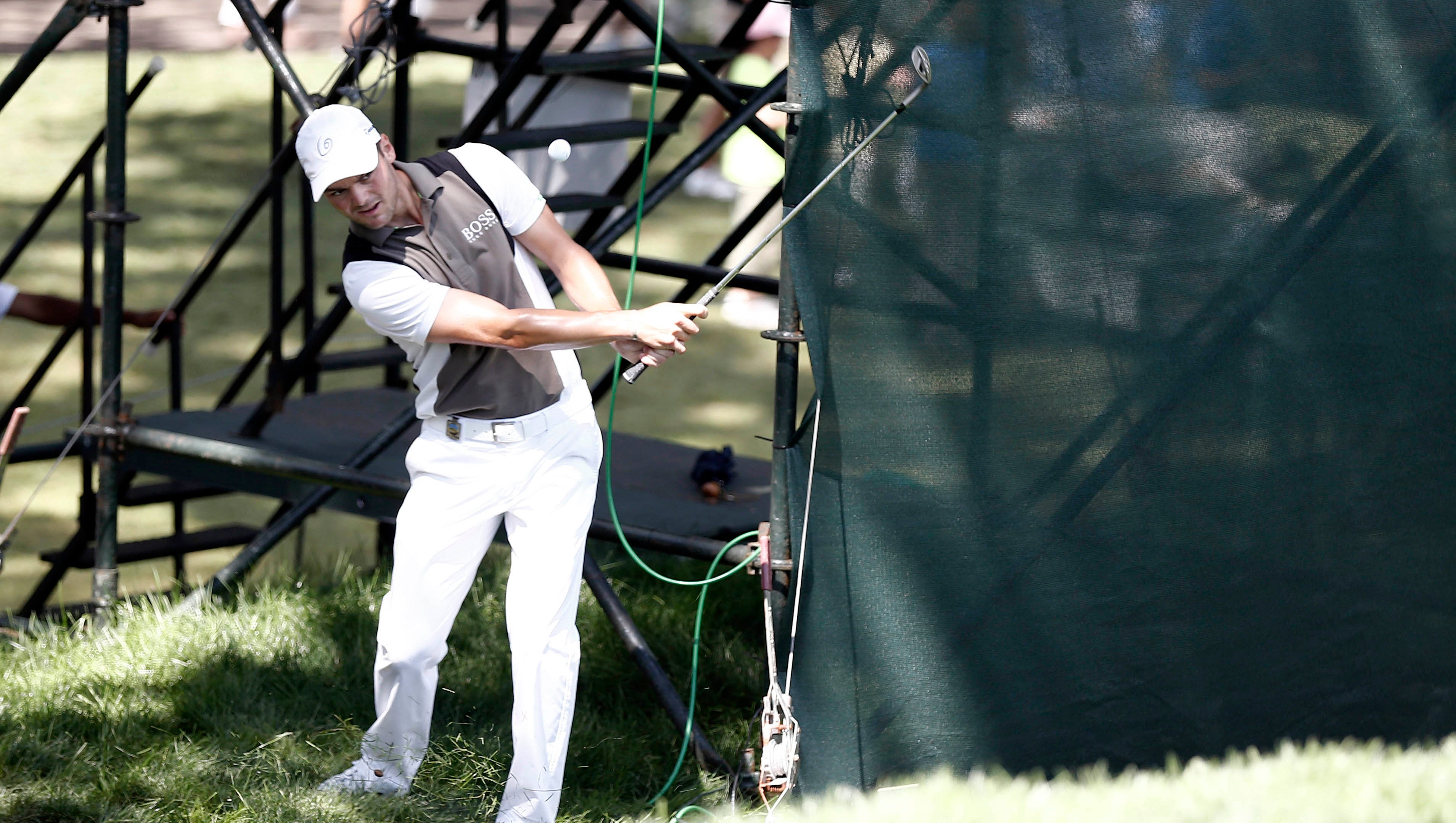 Martin Kaymer had some trouble at No. 3, chipping up to the green next to a TV tower.