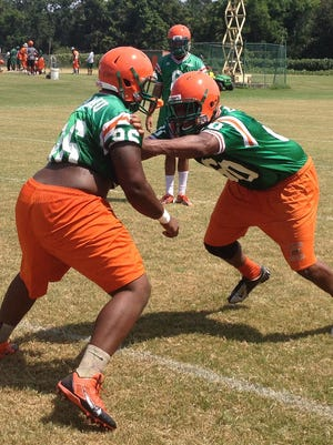 Defensive linemen Denzil Williams, left, and Brandon Forge face off during Tuesday's FAMU practice.