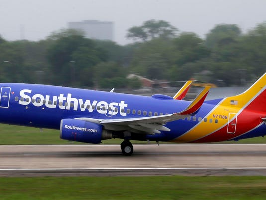 FILE- In this April 23, 2015, file photo, a Southwest airlines jet takes off from a runway at Love Field in Dallas. Southwest Airlines is asking travelers on Sunday, Oct. 11, to arrive at least two hours before their scheduled departures as technical issues are forcing it to check-in some customers manually. (AP Photo/LM Otero, File)