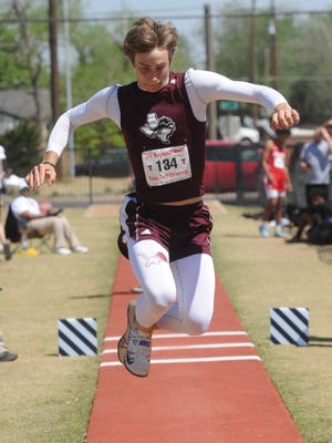 Brownwood's A.J. McCarty competes in the boys triple jump at the Region I-4A track and field meet Friday, April 27, 2018 at Lowrey Field in Lubbock. He won the event with a leap of feet, 33/4 inches.