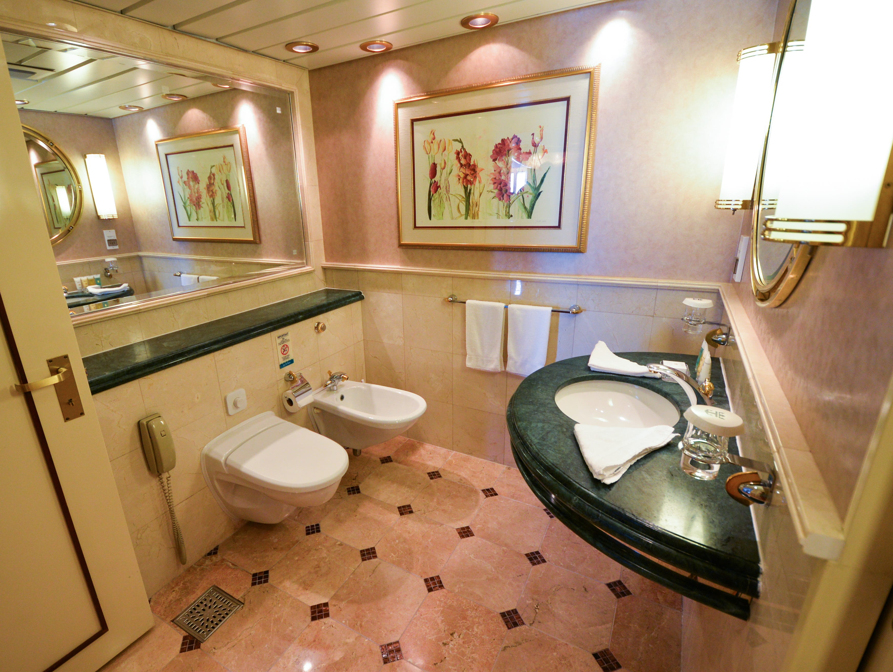 The Royal Suite master bathroom's toilet and bidet are separated into an attached room.