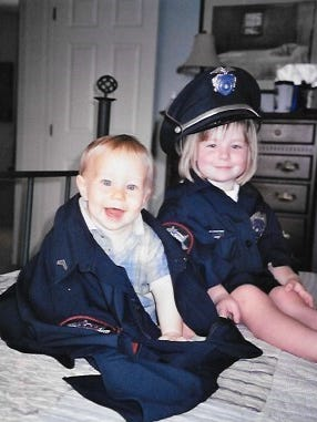 """Jessica Thomas is the wife of a local police officer. She felt compelled to write an essay following the shooting of police officers nationwide. She submitted this photo of the her children to accompany her essay. """"This pretty much sums up our life as a police family,"""" Thomas said."""