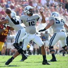 LOS ANGELES, CA - SEPTEMBER 21:  Chuckie Keeton #16 of the Utah State Aggies throws during the game against the USC Trojans at the Los Angeles Memorial Coliseum on September 21, 2013 in Los Angeles, California.  (Photo by Harry How/Getty Images)