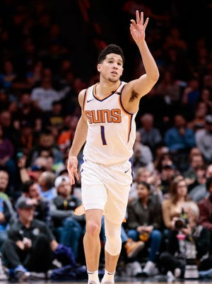 Jan 19, 2018: Phoenix Suns guard Devin Booker (1) gestures from the court after a play in the fourth quarter against the Denver Nuggets at the Pepsi Center.