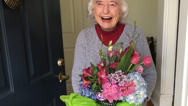 Topsfield resident Janet Brown, seen here receiving a Mother's Day flower delivery from Fresh Look Designs, is turning 100 Friday, Oct. 9.
