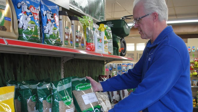 Dan Gerlach, one of the owners at Wisconsin Garden and Pet Supply, arranges lawn seed bags at the shop at 8520 W. North Ave., Wauwatosa. Gerlach said the business began as just a pet store in 1953 but after a few summers started selling garden supplies as well. He said the store prides itself on providing quality products paired with quality advice.