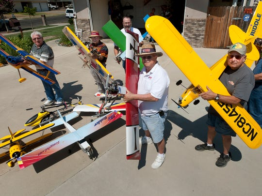 Condors R/C Modelers members show off the variety of the models on August 1.