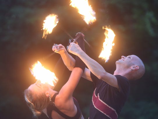 """The Boston Circus Guild performs during """"Night on Fire'"""