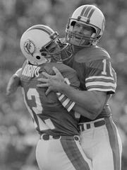 Dolphins' Tom Vigorito, left, of Wayne, congratulating QB David Woodley after Woodley's 76-yard TD pass to Jimmy Cefalo in Super Bowl XVII against the Redskins in 1983, in Pasadena, Calif.