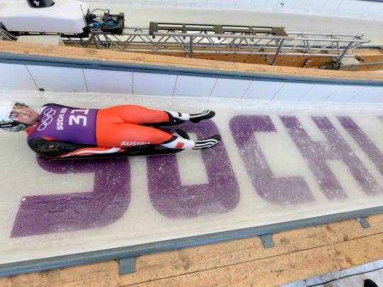 Krasnaya Polyana, RUS;  Daniel Pfister (AUT) participates during training for the men's singles luge at prior to the start of the Sochi 2014 Winter Olympic Games at Sanki Sliding Center.