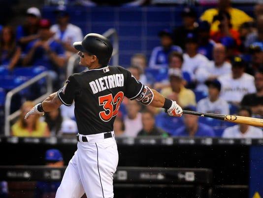 Miami Marlins' Derek Dietrich hits a home run in the first inning of a baseball game against the Chicago Cubs in Miami, Saturday, March 31, 2018. (AP Photo/Gaston De Cardenas) (AP Photo/Gaston De Cardenas)