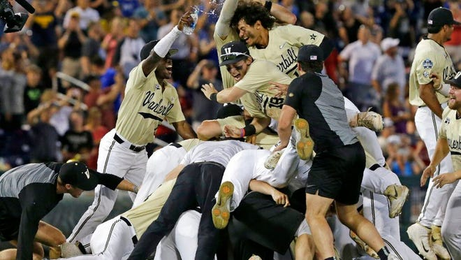 From June 26, 2019, Vanderbilt players celebrate after defeating Michigan to win Game 3 of the NCAA College World Series baseball finals in Omaha, Neb. The Commodores won their second national championship since 2014, beating Michigan in the College World Series finals. Vanderbilt's 59 wins set a Southeastern Conference record.