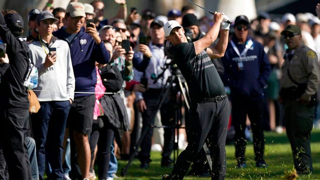 Brooks Koepka hits his second shot from the rough on the 13th hole during the third round of the Genesis Invitational golf tournament at Riviera Country Club, Saturday, Feb. 15, 2020, in the Pacific Palisades area of Los Angeles.