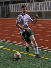 Captain Shreve's Gage Simpson moves the ball in their
