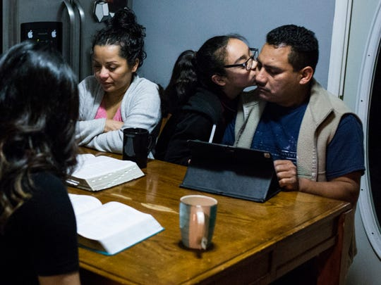 Diana Hernandez, greets her father Mario, as her mother,