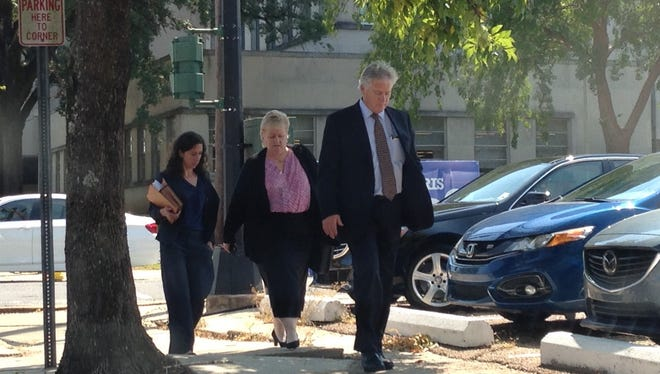 The defense team for Darrell Robinson (from left, attorney Matilde Carbia, an unidentified woman and attorney Edward Cassidy) leave the Rapides Parish Courthouse on Tuesday after a hearing.