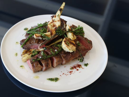 Dry Aged Porterhouse with Caesar butter prepared by