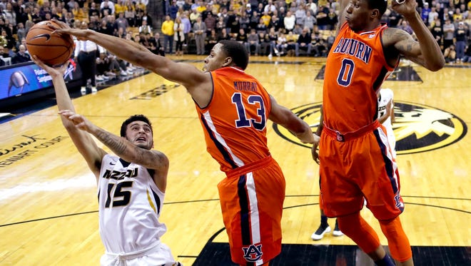 Missouri's Jordan Geist (15) has his shot knocked away by Auburn's Desean Murray (13) as Horace Spencer (0) watches during the first half of an NCAA college basketball game Wednesday, Jan. 24, 2018, in Columbia, Mo.