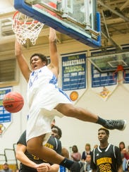 Stephen Decatur forward Keve Aluma (44) goes vertical