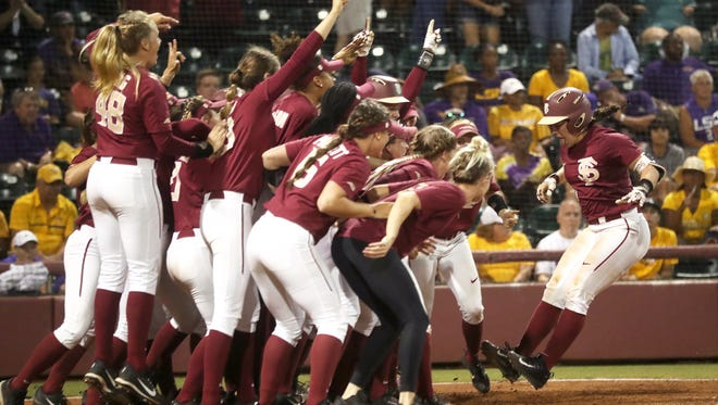 FSU's Anna Shelnutt, right, is greeted by her teammates after hitting a 2-run home run in the 11th inning against LSU during the second game of their NCAA Super Regional series at JoAnne Graf Field on Saturday, May 26, 2018.