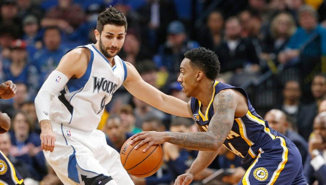 Indiana Pacers' Jeff Teague, right, drives past  Minnesota Timberwolves' Ricky Rubio, of Spain, during the first quarter of an NBA basketball game Thursday, Jan. 26, 2017, in Minneapolis. (AP Photo/Jim Mone)