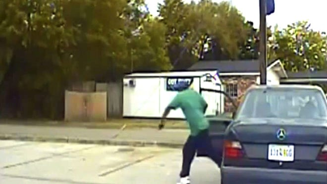 A frame grab from police dash cam video made available 10 April 2015 by the S.C. Law Enforcement Division reportedly shows Walter Scott as he starts to run from North Charleston police officer Michael Slager during a traffic stop in North Charleston. Many South Carolina patrol cars still have no video capabilities.