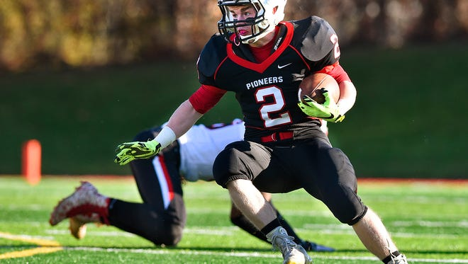 Pierz's Derick Hall breaks an Annandale tackler and looks for an open lane to run in the first half Saturday, Oct. 4 at Husky Stadium.
