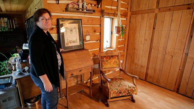 Nadine Arndt stands in a room in her Fond du Lac home where her mother, Sarah Owens, received hospice care before her death.